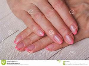 French Nail Art In Light Pink Colour On Wooden Background ...