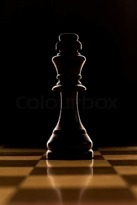 backlit chess piece king stock photo colourbox