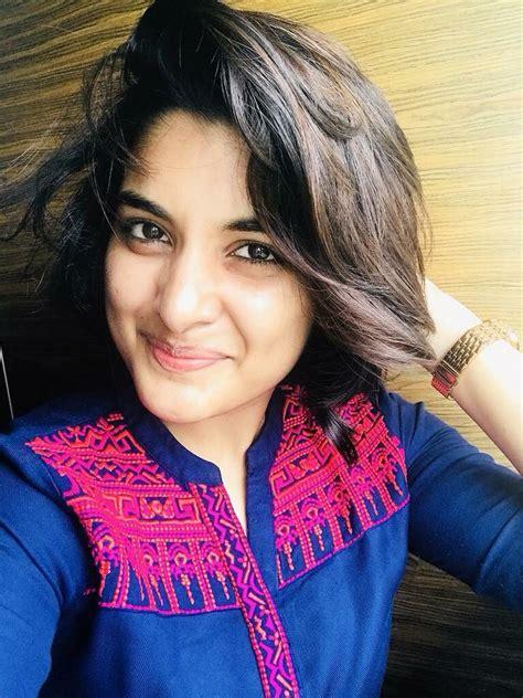 actress nivetha thomas  cut  hair short