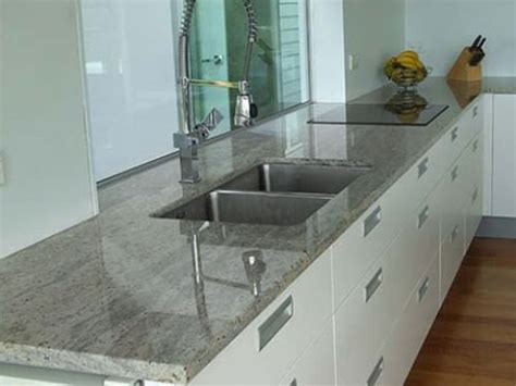 white kitchen cabinets with gray granite countertops top