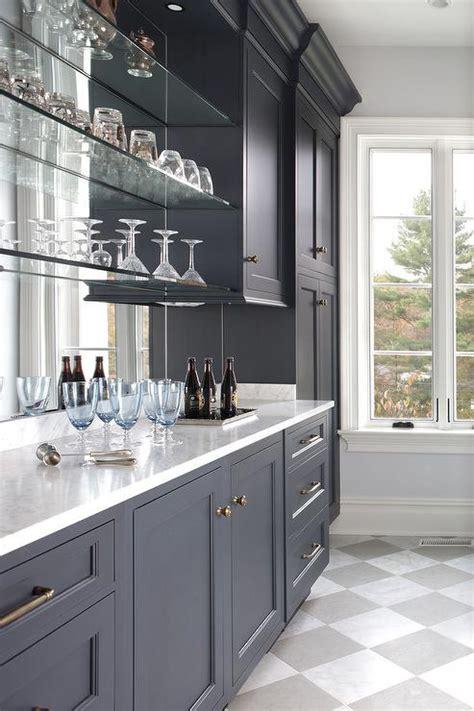 Floating Glass Cabinet - antiqued mirror pattern tile backsplash
