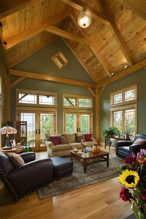 family room with wooden vaulted ceiling and sage walls