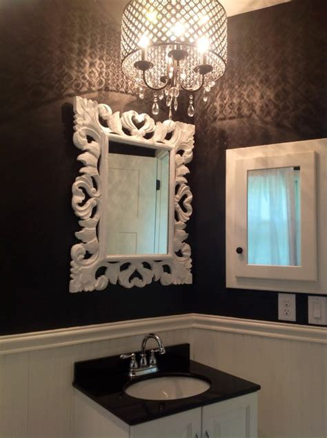 black and white bathroom with chandelier