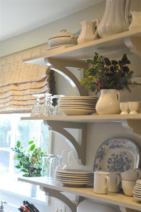 white open shelves  brackets white dishes