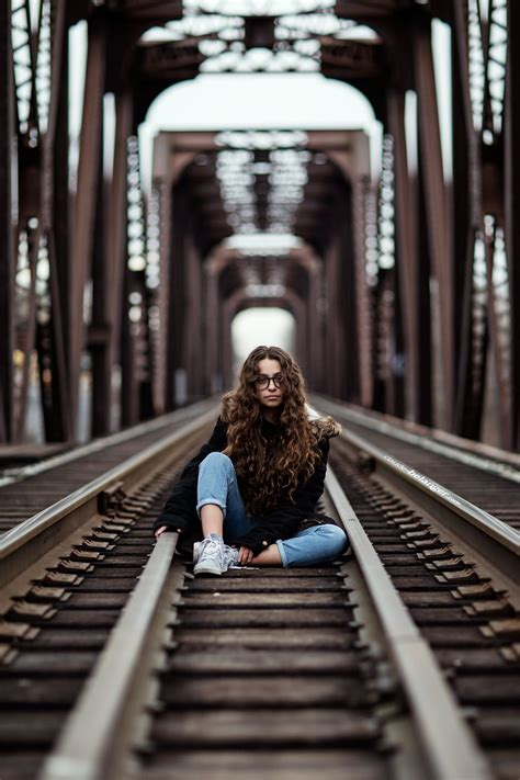 young girl sitting   abandon train track