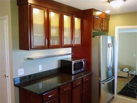 Cherry cabinets and backlit frosted glass doors   Reinke