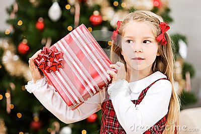 christmas girl shakes present  hear