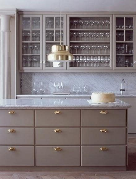 grey kitchen cupboards  gold hardware  decorate