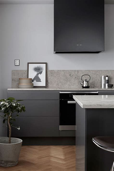 black and grey kitchen ideas 30 grey kitchens that you ll never want to leave digsdigs 207 | 21 a modern sleek dark grey kitchen with a black hood white countertops and a grey stone backsplash looks very stylish