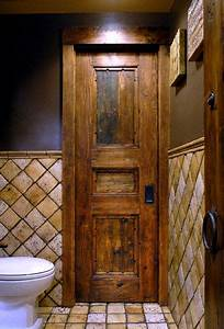 Reclaimed wood pocket door photo by bob brazell doors for Barnwood pocket door