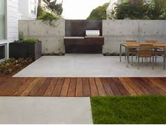 Modern Patio Gardening Outdoor Contemporary Exterior Of Home With BP Glass Garage Door Cedar Siding Bluestone Patio Seating Area White Cape Cod Patio Cover Stout Design Creating Outdoor Living Spaces On A Budget Outdoor Living Direct
