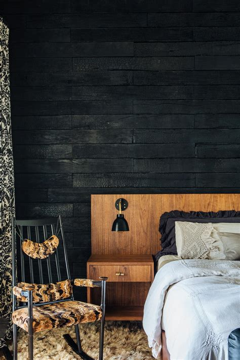 profile midcentury bed  charred wood wall hgtv
