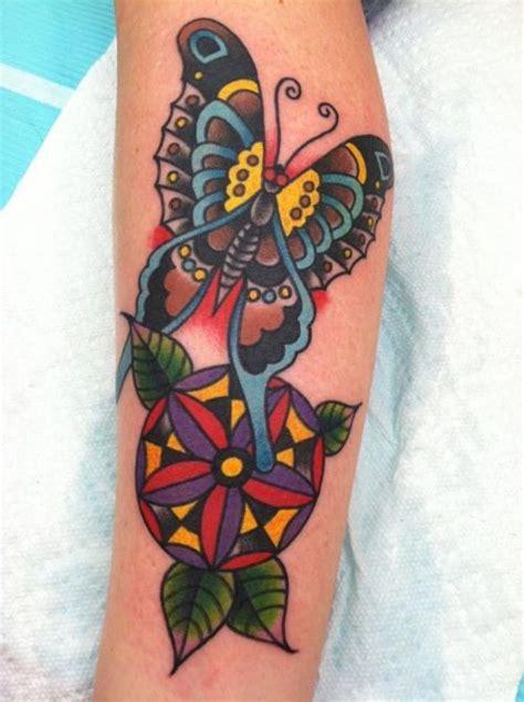 school butterfly mandala tattoo ink