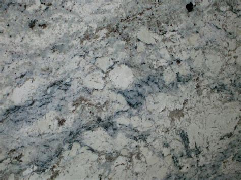 grey and blue veining in a white granite slab decoist