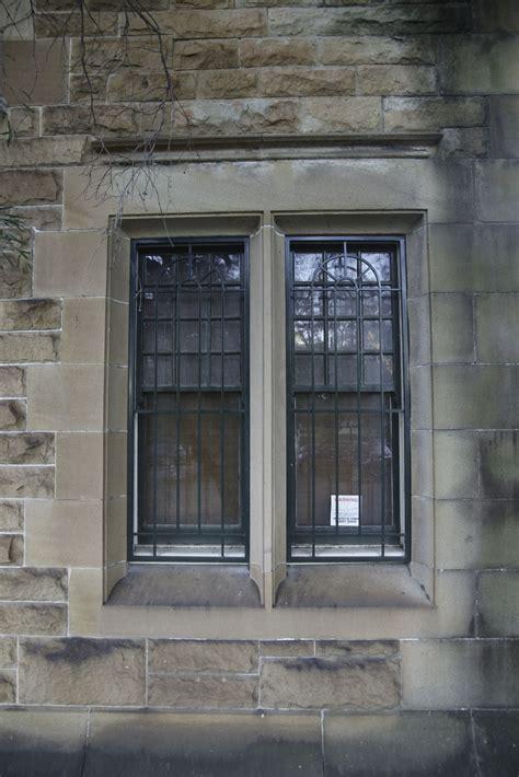 barred window  brick wall background texture www