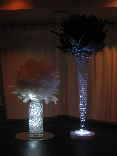 black  white feather ball centerpieces  trumpet