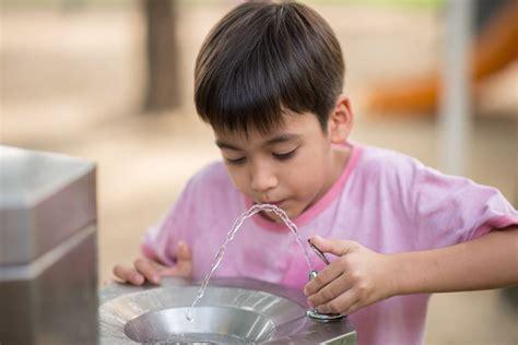 children  drinking lead laden water  school