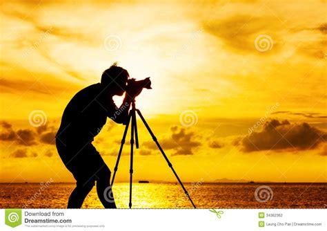 12238 photographer tripod silhouette silhouette of photographer with tripod stock photo image