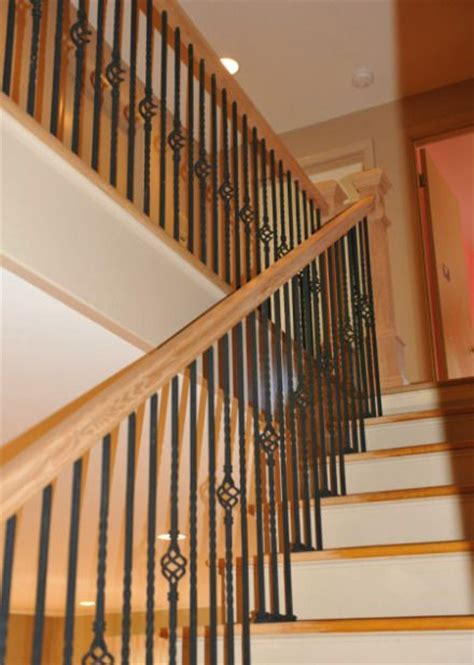 Oak Banister Rails by Oak Staircase And Wrought Iron Railing Our Basement