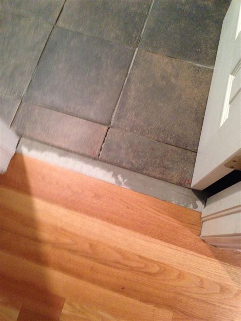 Looking for ideas on transition from tile to wood : DIY