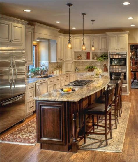 kitchen cabinets islands ivory cabinets with a chocolate glaze coordinate well with