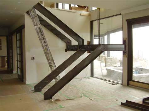 floating wood floor s15 side stringer staircase treads being installed