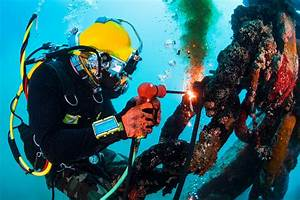 Operations Specialist Navy Navy Diver Performs Underwater Cutting Operations Using A