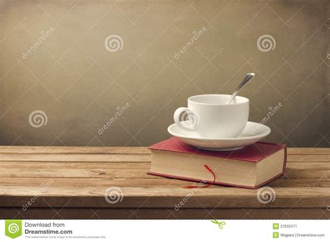 Cup of coffee and book stock image. Image of beverage   27632471