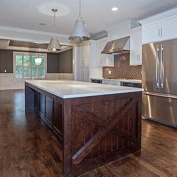 white cabinets  dark brown kitchen hood transitional