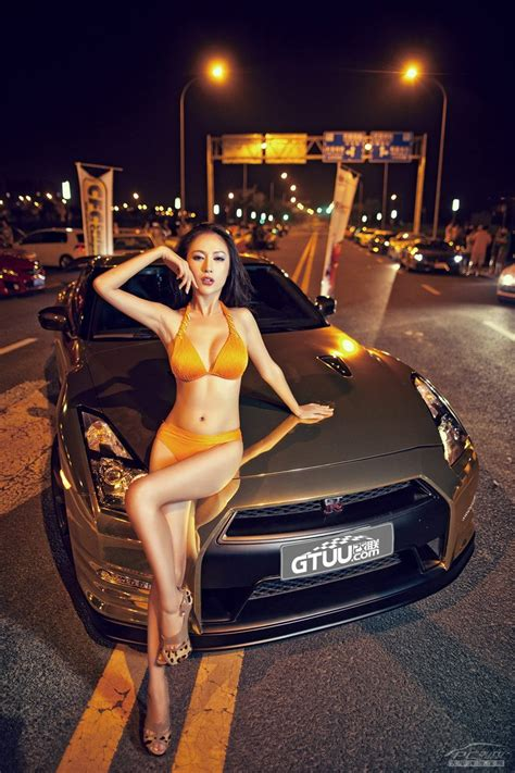 chinese model poses  gold wrapped nissan gtr