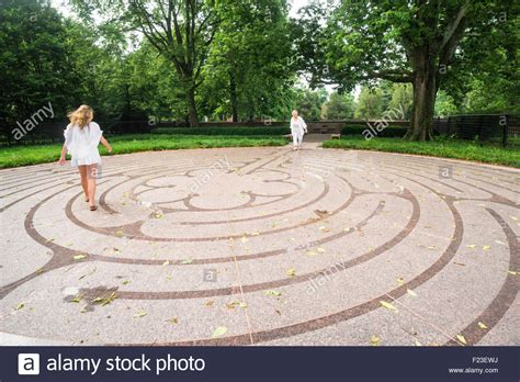 Two Blond Females Walk The Path At Cathedral Labyrinth, A