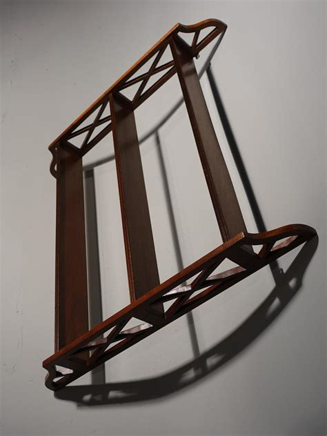 mid  century hanging rack  chinese chippendale influence