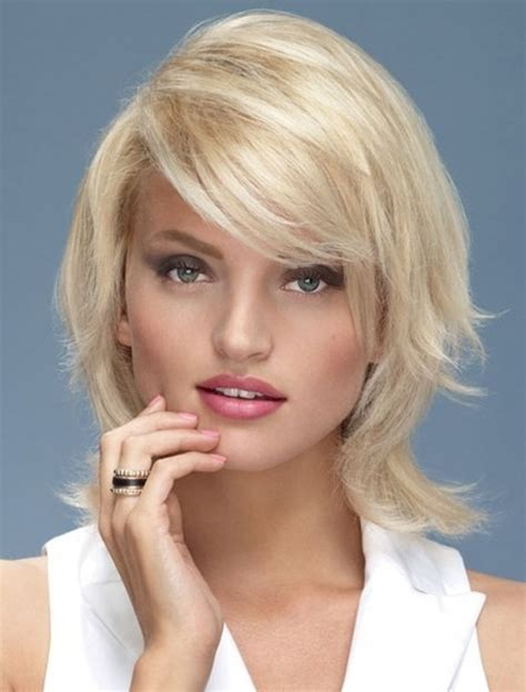 medium length layered hair with bangs hairstyle for