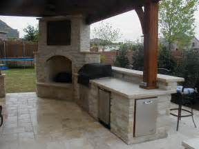 Outdoor Kitchen with Fireplace and TV