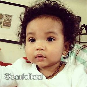 Beautiful baby girl with chocolate brown eyes and curly ...