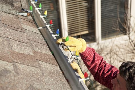 install christmas decorations on roof don t fall for lights illuminating safety in