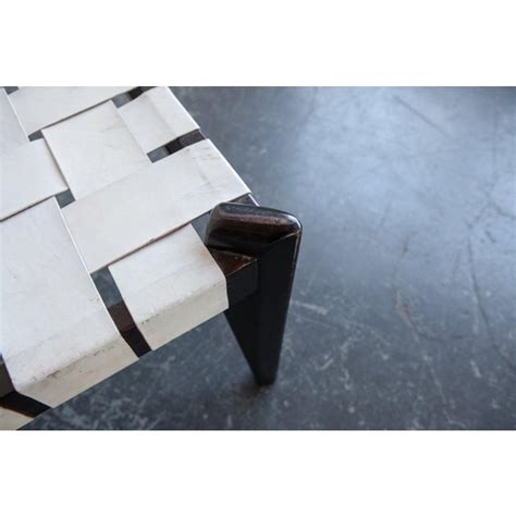 The section that supports the legs is lacquered metal. Woven White Leather Coffee Table | Chairish