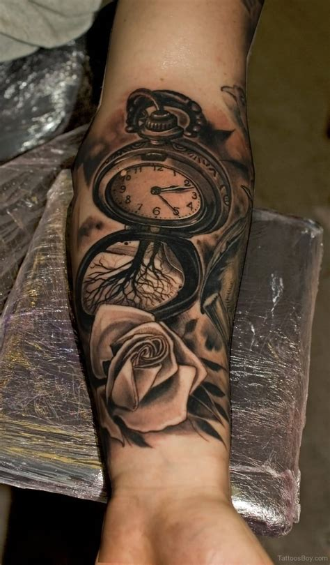 watercolor clock tattoo   forearm