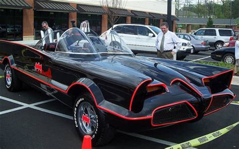 Original Batmobile Autographed By 1966 batmobile replica on ebay comes with serious batgadgetry