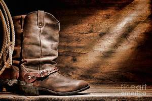 Cowboy Boots On Wood Floor Photograph by Olivier Le Queinec