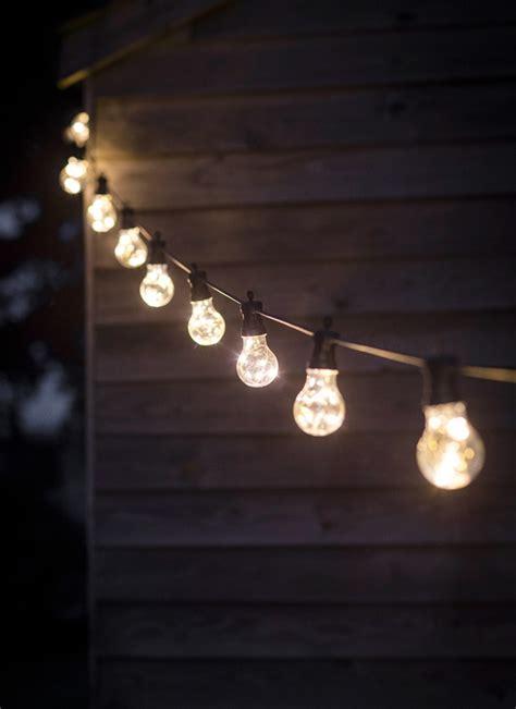 concrete dining table festoon lights 10 bulbs garden trading