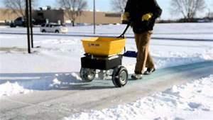Pk100 Spreader Spreading Ice Melt On The Sidewalk
