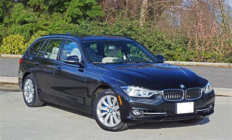 bmw  xdrive touring road test review  car