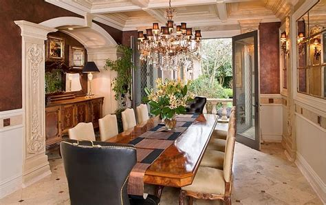 Ornate Dining Room With Double Doors That Open To A Patio