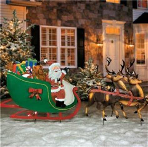 fashioned santa claus reindeer sleigh metal yard art