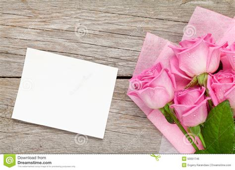 pink roses bouquet  blank greeting card  wooden