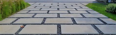 large concrete pavers beautiful garden with tree border