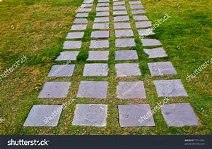 Stone Block Walk Path In The Park With Green Grass Stock ...
