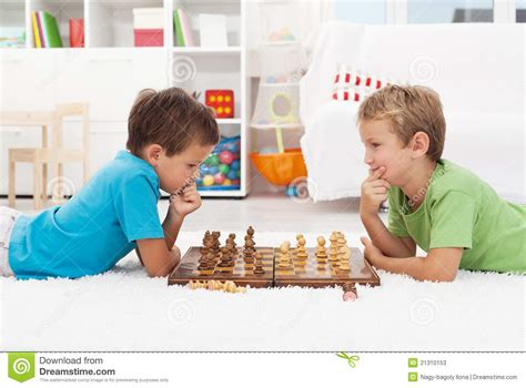 Two boys playing chess stock image. Image of learning   21310153