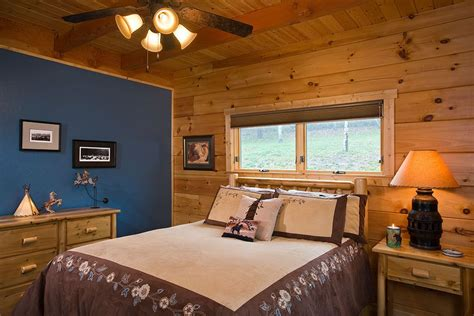spare bedroom   beautiful deep blue drywalled interior wall  solid log exterior walls